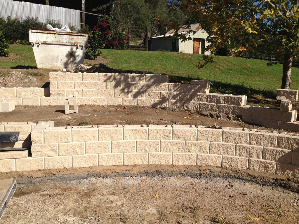 Retaining & Retention Walls-Midland TX Professional Landscapers & Outdoor Living Designs-We offer Landscape Design, Outdoor Patios & Pergolas, Outdoor Living Spaces, Stonescapes, Residential & Commercial Landscaping, Irrigation Installation & Repairs, Drainage Systems, Landscape Lighting, Outdoor Living Spaces, Tree Service, Lawn Service, and more.